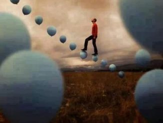 Picture of a man walking up a serious of ballons.